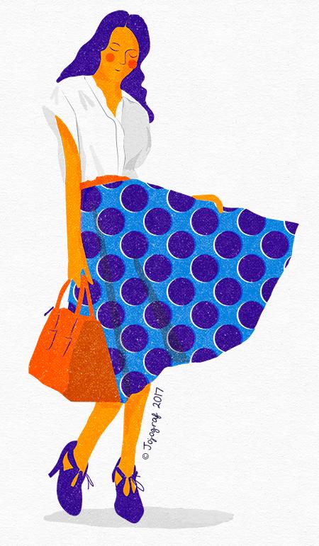 Flicka med prickig kjol
